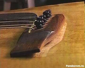 какая должна быть высота струн на гитаре