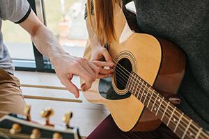 за сколько можно научиться игре на гитаре